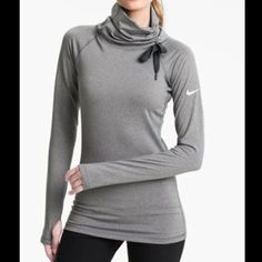 Nike Pro Hyperwarm Hybrid Training Pullover Top New without tags! Inside is super soft, the funnel neck drawcord allows you to adjust the fit (you can even tie it as a bow for a girly vibe). And of course the thumb holes on the sleeves are an added bonus! I have this in another size and it's one of my favorites for going out on runs when it's chilly. Nike Sweaters Cowl & Turtlenecks