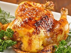 Cornish Game Hens with Bourbon Glaze: An excellent choice for a small holiday gathering or casual dinner party, these roasted Cornish game hens are flavored with a sweet-smoky glaze made with bourbon and honey.