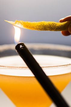 Watch and learn how to make a citrusy sidecar cocktail with a burnt lemon peel garnish.
