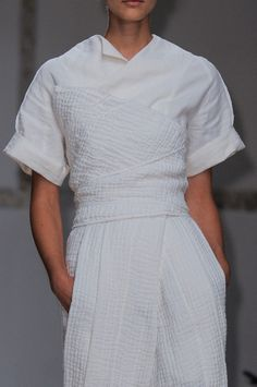 Another all white look. More mannish with a great texture. Not sure how these pieces work, hard to tell.  Aganovich Spring 2014