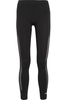 """adidas by Stella McCartney's leggings have perforated panels along the sides - """"for me style doesn't have to be sacrificed for sport, I want to look feminine and cool,"""" Stella explains. This high-rise pair is cut from stretch-jersey and has an elasticated waistband for flexibility when training."""