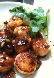 Seared scallops with orange glaze - The ground pepper, orange and soy combination was quite a hit.This recipe had the perfect kick to it.