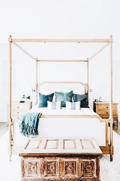 Look at all that natural light, love the bed frame, looks so good, not sure I'd ever actually have it though!