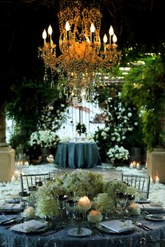 .love the color combo and all the greenery... and the chandalier of course