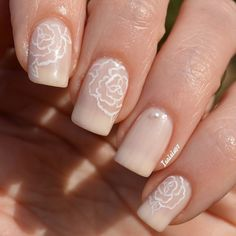 Floral inspired nude nail art design. make your nude nail art have more life by adding line details of flowers by the cuticle area in striking white polish.