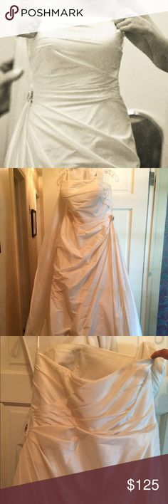 Ivory Silk Taffeta wedding gown Saison Blanche, it has been altered and worn once. Size 16 but fits as a 12. The Swarovski crystal needs a stitch or two to be seen down and dress would probably need to be dry cleaned and steamed. Paid $800 only asking $125. Dresses Wedding