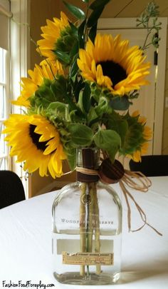 Inspirational Sunflower Wedding Table Decorations - Ideas to decorate your home in a sunflower theme! Wedding Table Decorations, Wedding Arrangements, Floral Arrangements, Sunflower Centerpieces, Bottle Centerpieces, Liquor Bottle Crafts, Liquor Bottles, Patron Bottles, Sunflower Kitchen