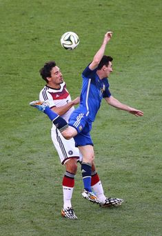 Mats Hummels of Germany and Lionel Messi of Argentina compete for the ball during the 2014 FIFA World Cup Brazil Final match between Germany and Argentina at Maracana on July 13, 2014 in Rio de Janeiro, Brazil.