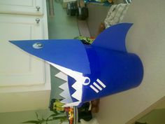 Shark bucket for the little surfer Halloween Costume :) Just foam cut out, and big googly eyes glued on.