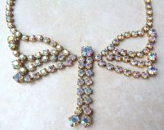A stunning, vintage,  large rhinestone butterfly necklace .  This is a lovely,  large statement piece, the stones are light catching aurora borealis rhinestones,  set along the whole necklace length, with two triple swag areas forming the butterflies wings and two long rhinestone drops, from a large central rhinestone, forming the butterflies body