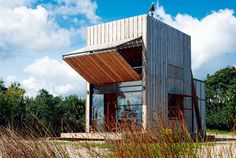 Transformer or beach hut? Positioned in a coastal erosion zone, this holiday retreat for a family of five is completely capable of being relocated. An oversized shutter allows for protection from the elements when not in use and opens to allow sun in during the winter or provide shade on hot summer days. Waikato, New Zealand. By Crosson Clarke Carnachan Architects, from the book Rock the Shack, Copyright Gestalten 2013.