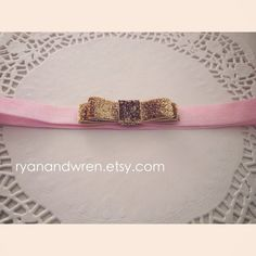 Pink headband with gold bow by ryanandwren on Etsy