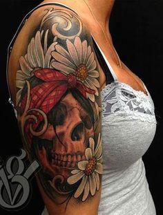 Feminine sugar skull tattoo - This is one unique sugar skull tattoo since it's got a head band and used daisies as the flower. #TattooModels #tattoo