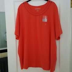 Catherine's shirt Coral shirt with mesh at the top. It's a coral/pink ish color, not as bright as the picture. The color is best show in the last picture. Brand new with tags, never been worn! Catherines Tops Tees - Short Sleeve
