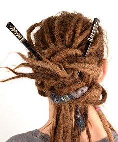 Black hairstick with white leaf pattern | Dreadstuff A great way to make a dreadlock updo. The hair sticks are a great decoration for making your dreadlocks look extra nice!