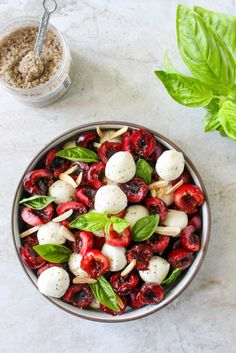 Cherry Caprese Salad with Toasted Almonds & Smoked Sea Salt from @yestoyolks