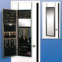 A door mirror that opens to organize jewelry! OMG I NEED THIS!