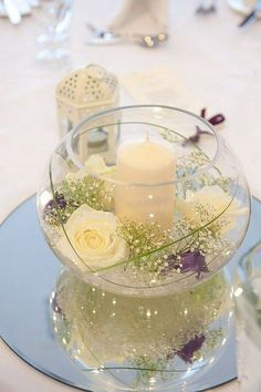 fish bowl 4 white flower wedding centerpiece / http://www.himisspuff.com/simple-elegant-all-white-wedding-color-ideas/3/