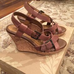 "SOFFT wedge sandals NEW Size 8 These cuties are seriously brand new. The wedge heel is 4"". SOFFT is known for super comfy shoes. I have a pair in another color so I don't need these. They deserve a good home.  The color is a taupe/brown color. Very pretty. Ours is a smoke free home. Sofft Shoes Wedges"