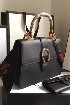 ea58019ff Gucci Dionysus Leather Top Handle Bag is a structured bag yet not too hard-  thanks