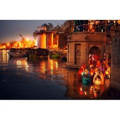 Photojournalist Emily Garthwaite (@emilygarthwaite) captured this moment throughout her journeys in #India. Here women make offerings at the #Ganges River in #Varanasi. Its the Maha Shivaratri Festival a yearly celebration of the #Hindu God Shiva. The sun is rising. I think my photographs are so colourful because I have Synesthesia which means that I can smell and sometimes taste color the artist writes. Follow along at @emilygarthwaite for more. Today happens to be the photographers 24th…