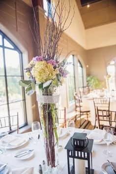 Tall centerpieces included hydrangeas, carnations, limonium, and dusty miller {The Harris Company, Photo and Cinema}