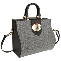 Sophisticated trunk design made of a combination of Starry Sky textured leather and smooth Black Napa leather, finished with the signature OYSBY lipstick clasp closure.  This bag is versatile, elegant and practical. Perfect for both daytime appointments and evening adventures.