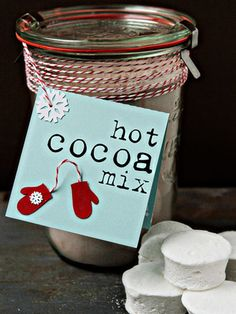 Put together an easy-to-make holiday gift by mixing the ingredients for hot cocoa in a jar and topping it off with homemade marshmallows.