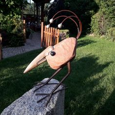 Bird sculpture handmade of red stone and steel. Dimentions: height 34 cm, Width 30 cm, Depth 20 cm, wight 3 kg.