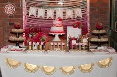 ombre white-pink-red yarn backdrop {Petite Party Studio}