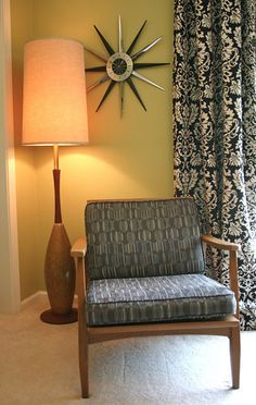 Hate everything except he idea, (lounge chair, chandelier floor lamp behind and large wall clock in corner)