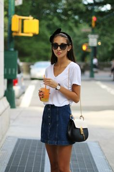 Felicia Akerstrom in a denim button front Topshop mini skirt