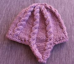This child's cabled hat is knit from the top down for a change. This makes the earflaps easy to knit, and also makes i. Knitted Hats, Knitwear, Knitting Patterns, Children, How To Make, Tops, Cable, Easy, Fashion