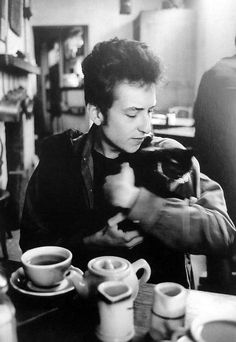 I've always loved this picture.  Bob Dylan in Greenwich Village with a kitty.  Photograph by Jim Marshall.