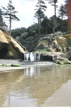a waterfall to the ocean at Hug Point State Beach, Oregon