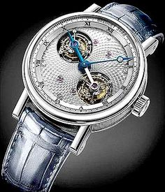 Manfacturer: Breguet    The Breguet Double Tourbillion comes hand-engraved with an image of the solar system.    This double-tourbillon watch has a 95 per cent pure platinum case while the blued-steel Breguet hands are wound manually and do not contain springs.