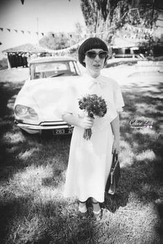 1970s wedding gown in the 1930s style with cape sleeves and bow. Photo by Celine Zed. Groom with moustache and bow tie, bride in sunglasses!