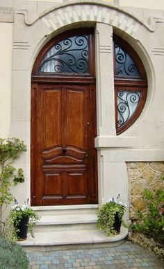 Gorgeous art nouveau inspired door and transom window.