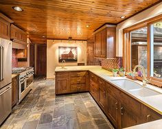 quartz counters and knotty pine cabinets