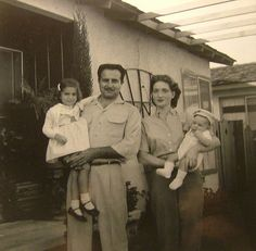 Louis Bartolotti Family, 1957, Anaheim CA. L to R: Carma Lynne Bartolotti, Louis Bartolotti, Hazel Higgins Bartolotti, Michael Louis Bartolotti, posing in front of our home in northwest Anaheim. This is a definite favorite of mine.