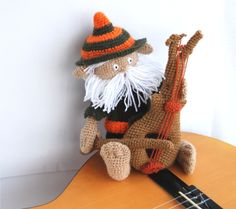 stuffed fairy doll, crocheted gnome, musician amigurumi goblin with instrument, tiny bearded man, OOAK, orange, brown, darkolivegreen. $38.00, via Etsy.