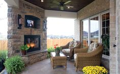 Covered Outdoor Living Spaces outdoor covered patio with flat screen television Tv Over Fireplace, Fireplace Ideas, Fireplace Stone, Fireplace On Porch, Gazebos, House Plans And More, Outside Living, Outdoor Rooms, Outdoor Kitchens