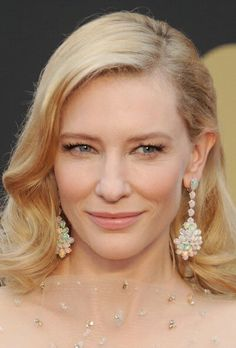 Oscar winner Cate Blanchett in opal and diamond earrings from Chopard.