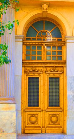 OLD DOOR OF A NEOCLASSICAL BUILDING IN MITROPOLEOS STR
