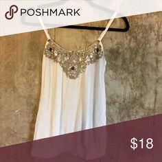 Express white embellished tank top Pretty embellishments to spice up your classic white tank top. Worn several times, but hand washed and ironed. Express Tops Tank Tops