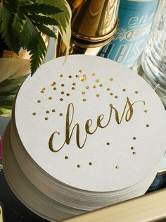'Cheers' coasters with gold foil