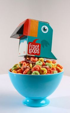 A Froot Loops cereal box that looks like a toucan.