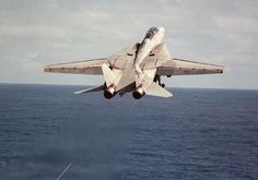 F-14 Tomcat: A US Navy (USN) F-14D Tomcat aircraft assigned to Fighter Squadron Two (VF-2) takes off towing an aerial gunnery target, during Western Pacific 2001 (WESTPAC'01) deployment, in support of Operation SOUTHERN WATCH