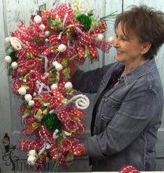Candy Cane Wreath tutorial by Trendy Tree using a candy cane form, snowball mesh, ribbons, RAZ Christmas sprays, includes video.