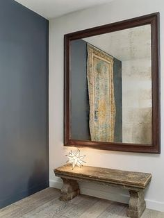 Gorgeous foyer idea. Star lamp and mirror.